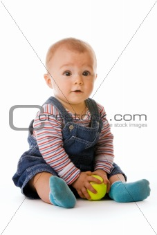 Small child in jeans with tennis ball