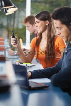 group of three people in library