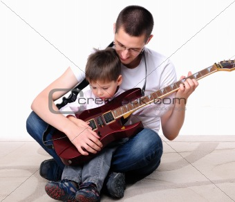 young father teaches his young son 