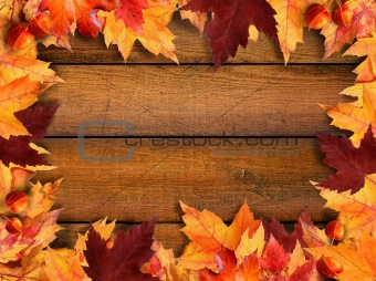 Autumn leaves frame on wood