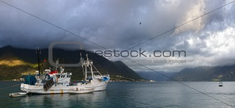 fishing boat on a mountain bay