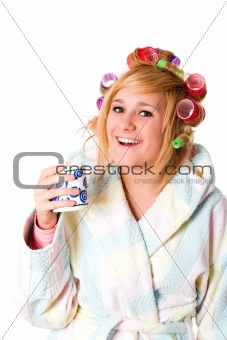 housewife with curlers and cup