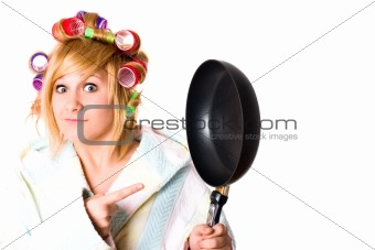 funny housewife with curlers and pan