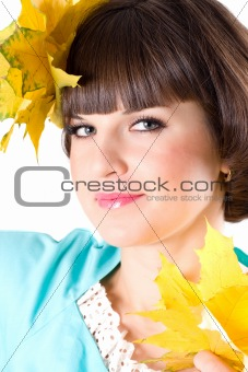 beautiful young woman with yellow leaves