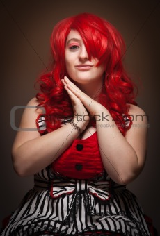Attractive Red Haired Woman Portrait on a Grey Background.