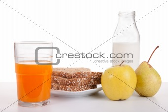 Breakfast: juice, fruit (apple and pear), bread, cereal and milk, isolated on white, studio shot