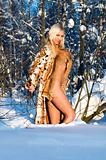 Naked beauty in the winter forest