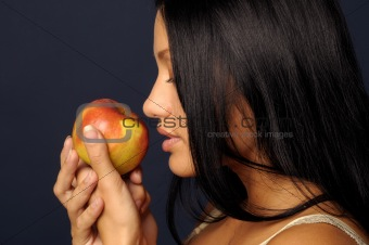 Beautiful girl is keeping the apple