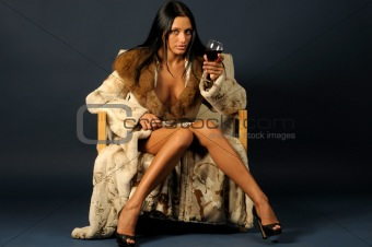 woman in furs witn wine.