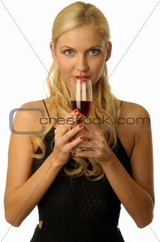 blonde girl in evening dress is drinking wine