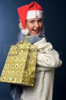 blonde girl in santa hat with gift bag