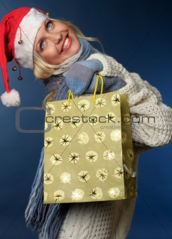 blonde girl in santa hat with gift bag