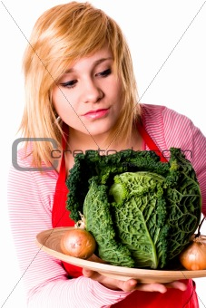 beautiful woman with fresh savoy cabbage and onions