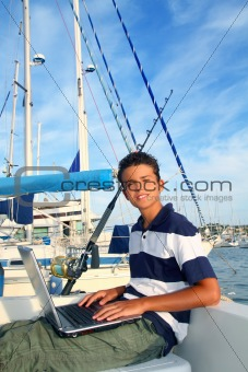 teenager on boat with laptop