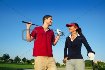 young couple on golf course