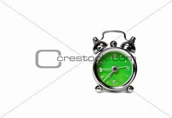 green alarm clock over white