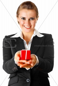 smiling modern business woman holding present in hands