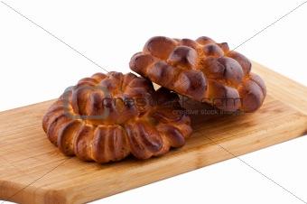 Bread rolls board on white background.