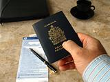 Businessman holding Canadian passport