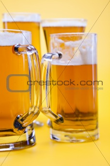 Beer glass with yellow background