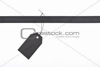 Black ribbon with tag