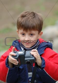 Boy with a camera.