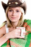girl in a cowboy hat with cup of tea