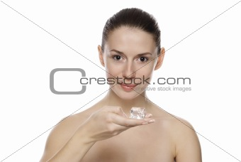 Portrait of young beautiful girl holding ice cube