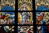 Leaded glass window in church of Alsemberg (close to Brussels in Belgium), made in 1895. Depiction of resurrected Jesus and the apostles (Pentecost).