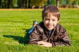 Little boy lying down on the grass