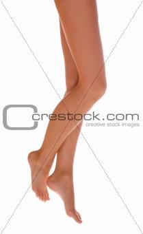 Beautiful female legs on white background.