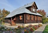 Beautiful wooden house with flowers, autumn