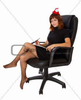 Business woman with new year hat is sitting at chair