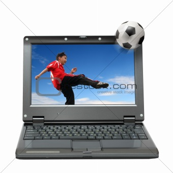 laptop with boy playing football