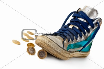 Gold coin rolled under the sneakers.