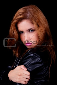 Beautiful woman, embracing, isolated on black background. Studio shot