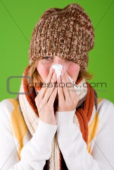 sneezing woman with handkerchief