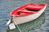 Red small boat.