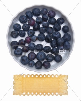 Fresh Bowl of Blueberries with Vintage Grunge Label.