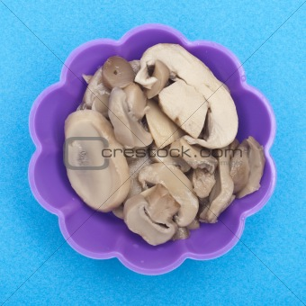 Canned Mushroom Slices in a Vibrant Purple Cup