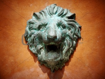 Cast green metal lion head