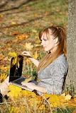 Autumn girl with laptop