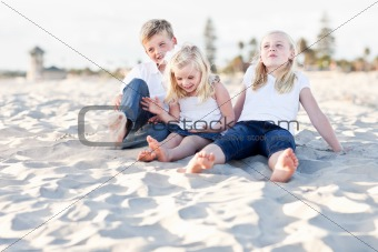 Adorable Sisters and Brother Having A Lot Fun at the Beach.