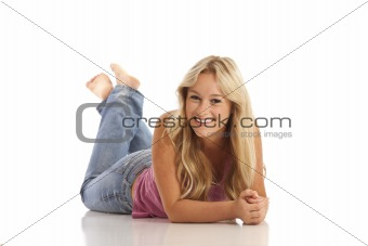 Portrait of casual young girl with jeans laying on floor