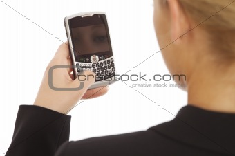 Back view portrait of young business girl texting on cell phone