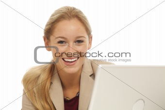 Portrait of young business girl sitting at desk with laptop