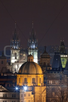 czech republic, prague - spires of the old town and tyn church at dusk