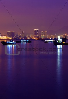Ship in harbour at night with reflection
