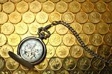 Pocket watch on money background, Hong Kong $0.5 coins