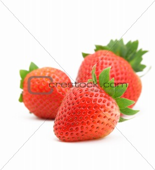 three strawberries on white background